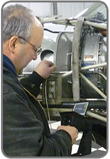 maintenance professional using VJ-Advance video borescope to inspect an engine