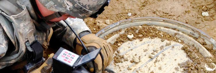 This is an image of someone using the VJ-Advance video borescope to inspect a possible bomb.
