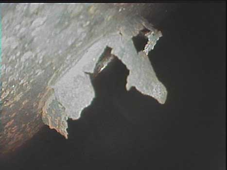 Helicopter airframe corrosion and rupture seen during an inspection as shown through a VJ-Advance video borescope