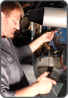 Maintenance professional using VJ-Advance video borescope to inspect an engine.